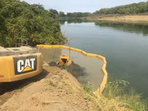 Maintaining water quality during installation with silt curtain